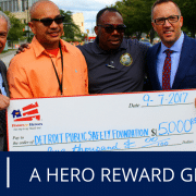 Homes for Heroes Specialist, Jamie Nummer, presents the Detroit Public Safety Foundation with a grant on behalf of the Homes for Heroes Foundation