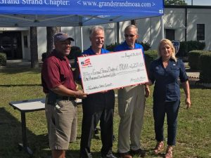 Homes for Heroes Specialist, Joanne Paskewich, presents the Grand Strand Chapter of the MOAA with a grant on behalf of the Homes for Heroes Foundation