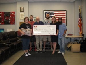 Homes for Heroes Specialist, Kimberly Stem, presents the Northeast Arkansas Chapter of the MOAA with a grant on behalf of the Homes for Heroes Foundation