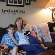 Stacey Porter sits with her two children, Isaac, 9, and Lucy, 7, in their new home. Megan Campbell/Kirkland Reporter