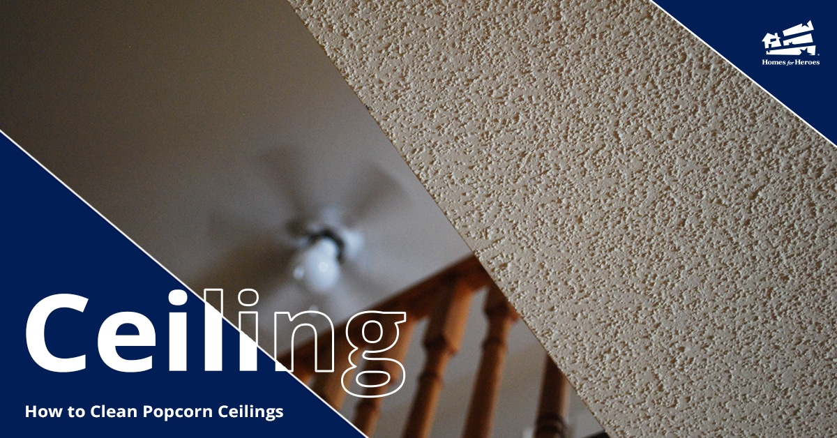 View looking up at a popcorn ceiling on one level and a lofted second level on the left half of the image