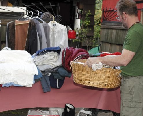 man selling his stuff at a yard sale