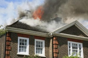 Brick home with roof on fire