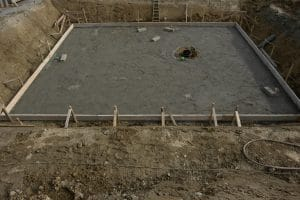 poured concrete foundation for a brick home