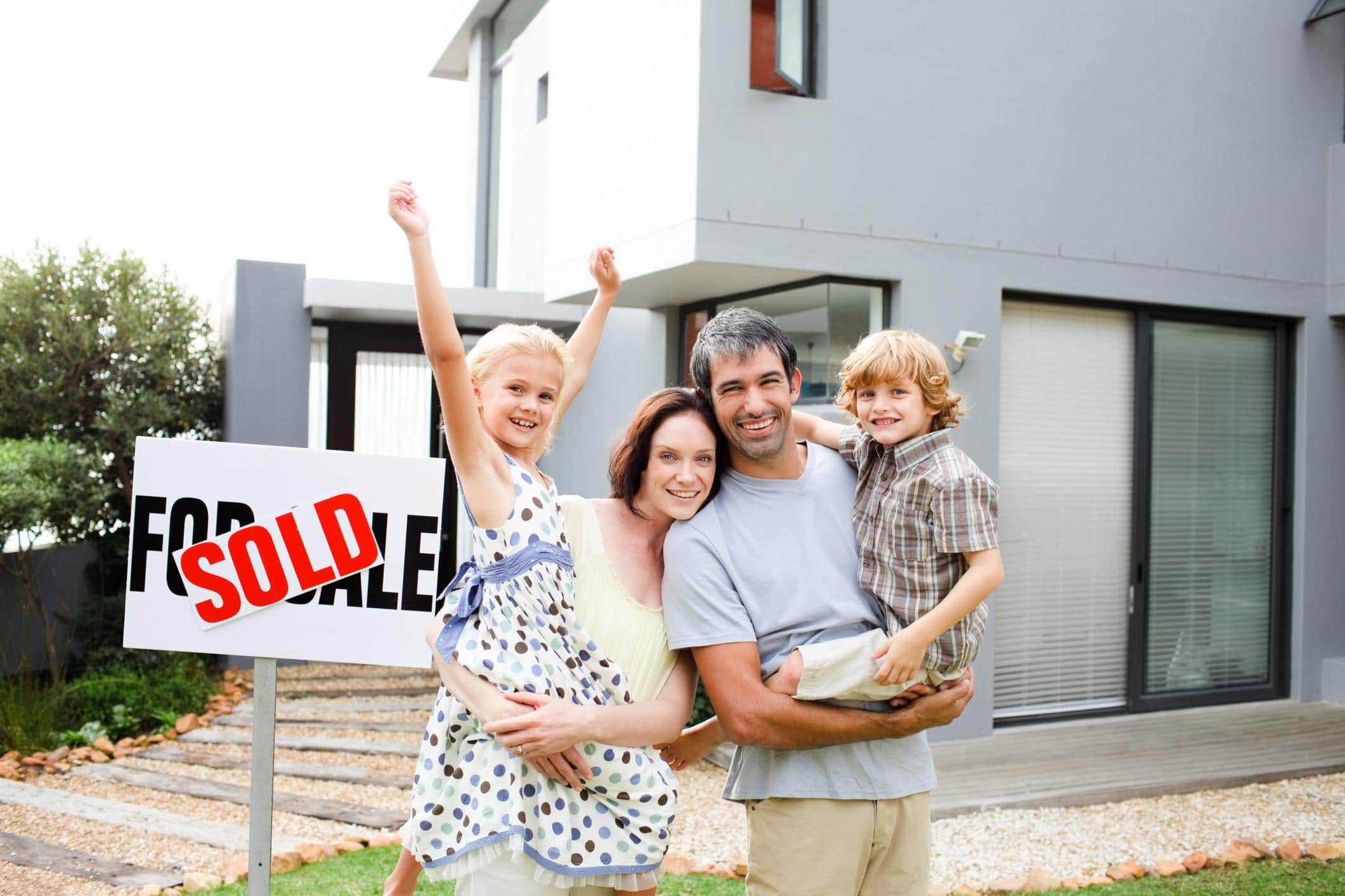 excited family that just bought their new home