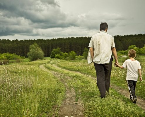 mentor walks with child to reinforce his success