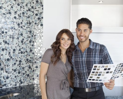 couple looking at model home choices