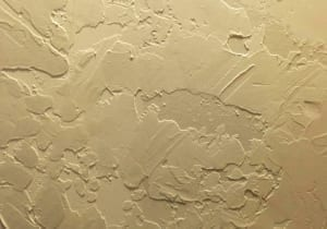 skip-trowel method of ceiling texture in off-white