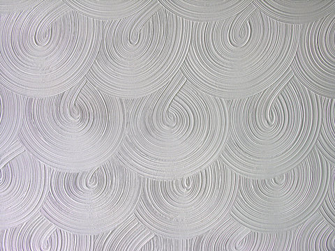 stucco pattern in a circle swirl on a ceiling