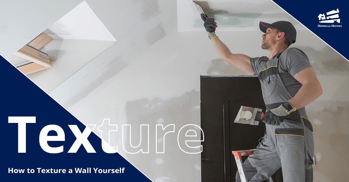 A man on a ladder is applying texturing process to his walls and ceiling