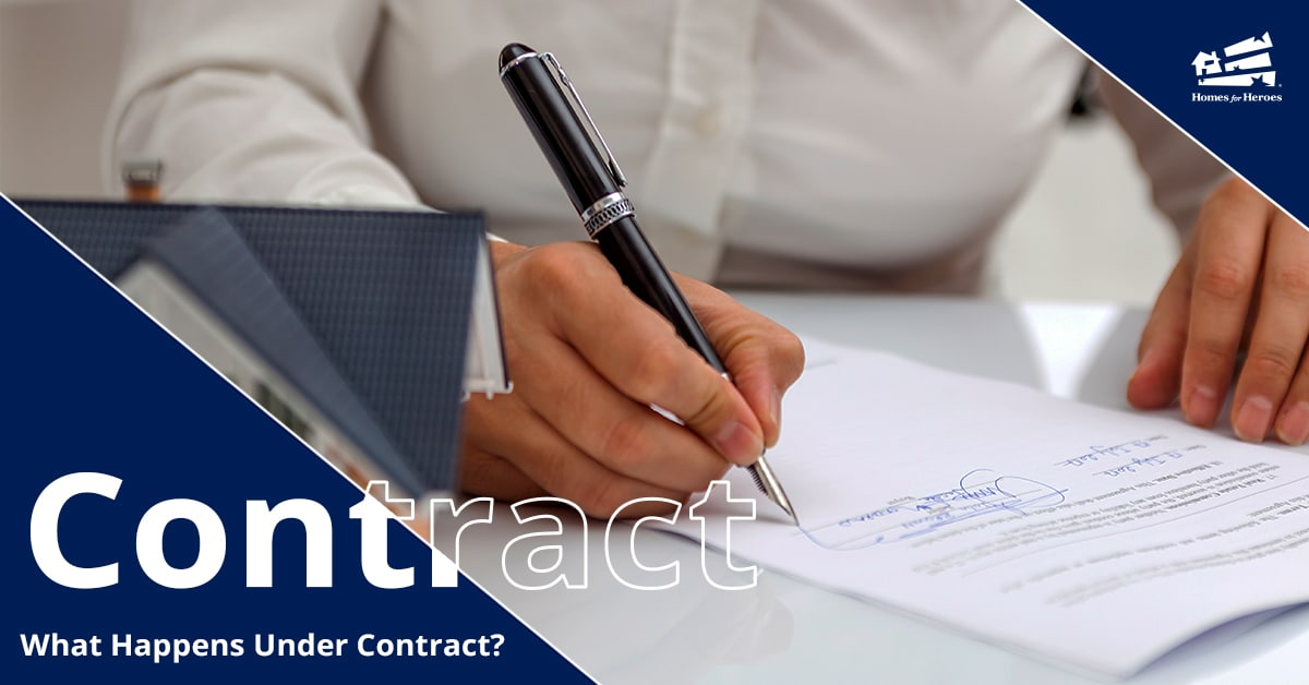 Person signing their name on a contract with a pen