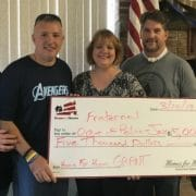 Homes for Heroes Specialist, Janet Saunier presents $5000 grant to the Fraternal Order of Police Jacksonville on behalf of the Homes for Heroes Foundation