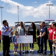 Rachel Flick is presented with a $5,000 grant from the Homes for Heroes Foundation