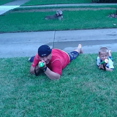 Father and son shooting water guns
