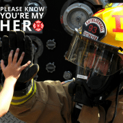 Firefighter hi-fiving a child