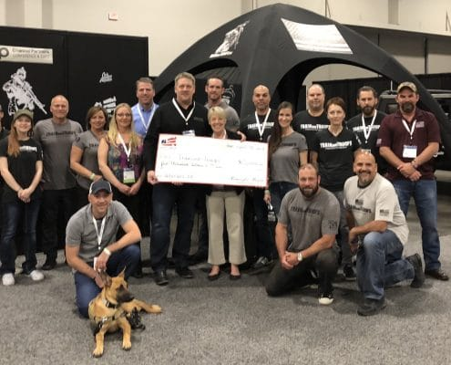 TrainOurTroops and Homes for Heroes holding Foundation Grant check
