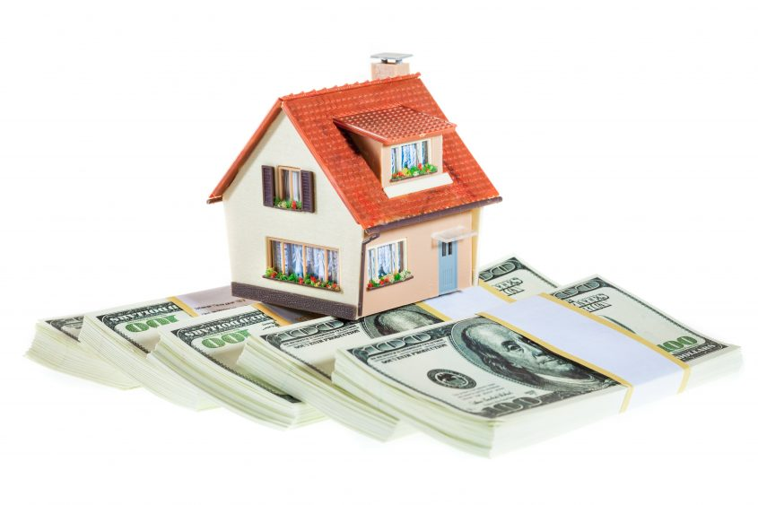 house on packs of banknotes for cash out refinance