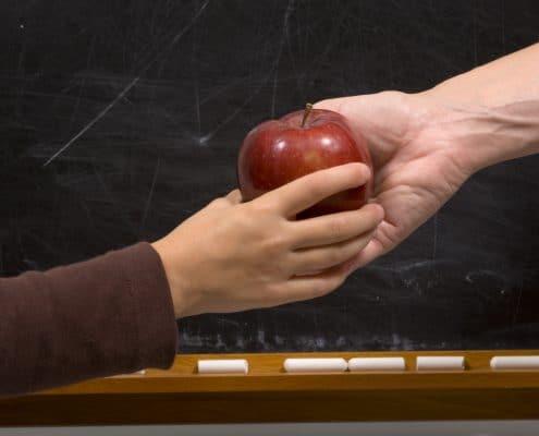 give an apple to a teacher