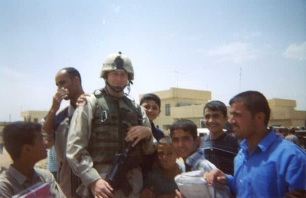 Army Soldier talking and laughing with citizens of Iraq