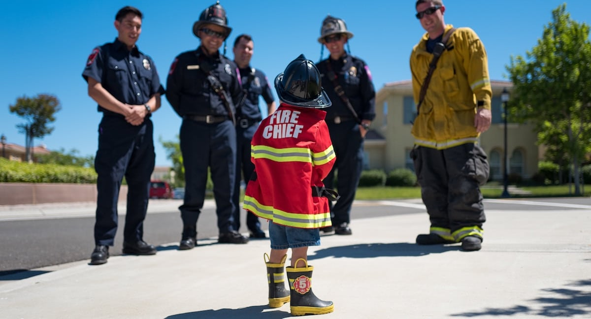 Child with firefighters