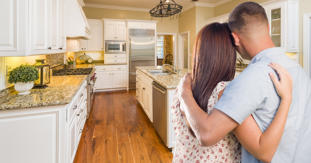 Hero-Couple-Looking-at-New-Kitchen