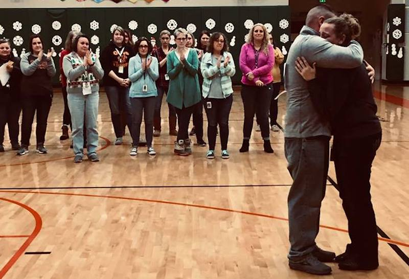 Laura and Ryan Hug at Homes for Heroes Christmas Gift Presentation at Olive Elementary in New Carlisle Indiana
