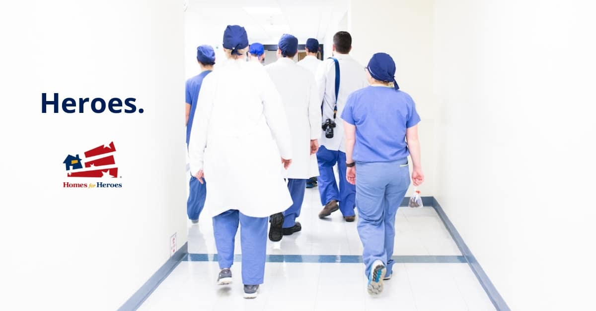 Heroes doctors walking hospital hallway luis melendez 530478 unsplash