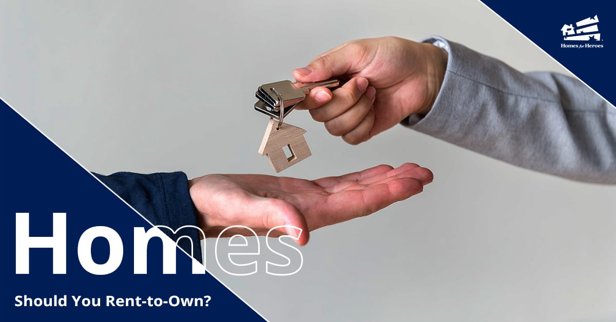 One hand placing a keyring with a house key and house keychain into the outstretched palm of another person
