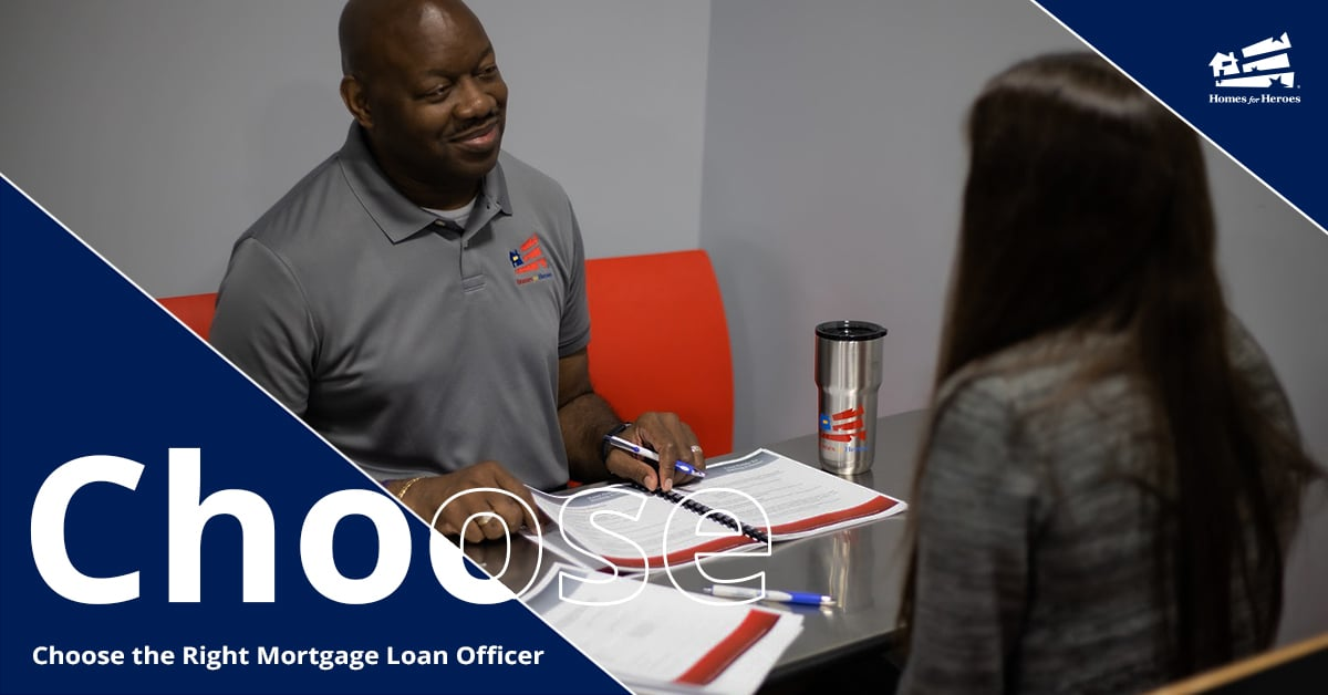 Male loan officer sharing paperwork with female buyer across a table