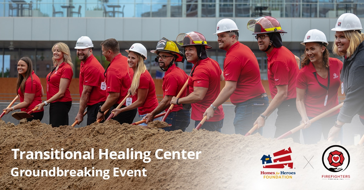 Firefighters and other board members throwing dirt with shovels at a ground breaking ceremony